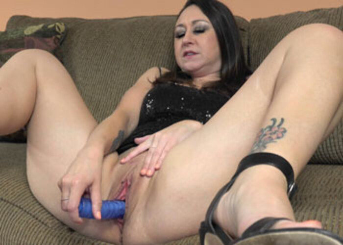Busty cougar Claudia's playing with a toy